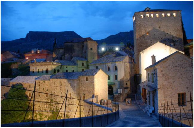 Mostar's old town glows in the evening light